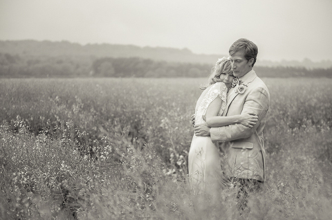 Kelly Reilly and Kyle Baugher moments after their wedding walking into a picturesque field in Somerset by Ria Mishaal Photography
